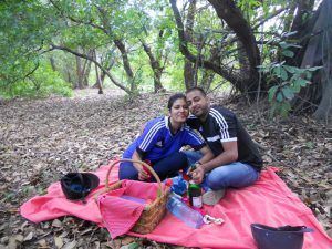 Couple having simple picnic in a forest
